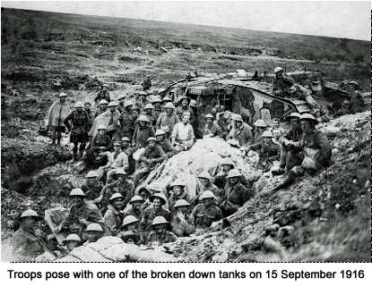 Troops pose with one of the broken down tanks on 15th September 1916